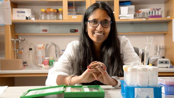 Shyni Varghese sitting at lab bench